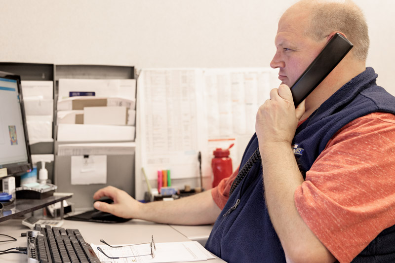 JOA technical staff on phone